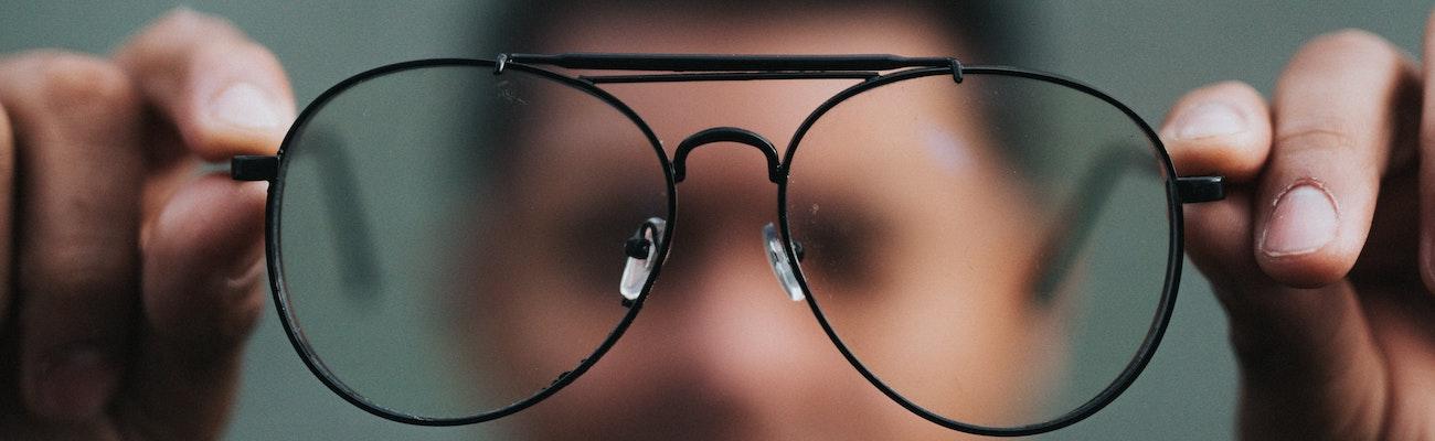 Man inspecting glasses