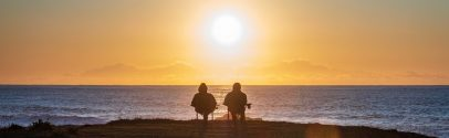 A couple sitting near a beach